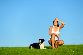 picture of working-dogs  - Tired sporty woman taking a running and exercising rest with her dog - JPG