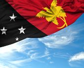 foto of guinea  - Papua New Guinea waving flag on a beautiful day - JPG