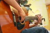 pic of guitarists  - The guitarist player sitting at the park - JPG