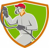stock photo of paint spray  - Illustration of car painter wearing face mask holding paint spray gun spraying viewed from the side set inside shield crest done in retro style - JPG