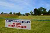 image of helicopters  - Warning sign informing that helicopters shall be operating from the area nearby - JPG