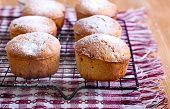 picture of icing  - Whole meal muffins with raisin coated with icing on wire rack - JPG