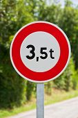 foto of restriction  - Traffic sign of 35 tons weigh restriction on a rural road background - JPG