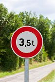image of restriction  - Traffic sign of 35 tons weigh restriction on a rural road background - JPG