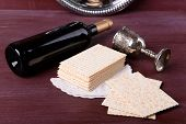 image of matzah  - Matzo for Passover with metal tray and wine on table close up - JPG