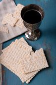 stock photo of matzah  - Matzo for Passover with metal tray and wine on table close up - JPG