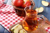 foto of jug  - Glass jug of apple juice on wooden table - JPG
