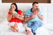 foto of twin baby girls  - Happy parents cuddling boy and girls twins - JPG