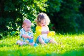 stock photo of girl toy  - Children playing in the garden - JPG