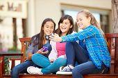picture of tweeny  - Group Of Girls Taking Selfie On Mobile Phone - JPG