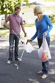 picture of pick up  - Couple Picking Up Litter In Suburban Street - JPG