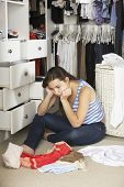 picture of wardrobe  - Unhappy Teenage Girl Unable To Find Suitable Outfit In Wardrobe - JPG