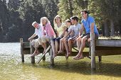 pic of jetties  - Three Generation Family Sitting On Wooden Jetty Looking Out Over Lake - JPG