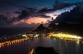 stock photo of ipanema  - Spectacular Sunset above Rio de Janeiro - Lagoon, Mountains, Leblon, Ipanema, and Gavea Neighborhoods Illuminated in the Dark. ** Note: Soft Focus at 100%, best at smaller sizes - JPG
