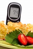 image of diabetes  - Pieces of fresh baked yeast cake with crumble and strawberries and glucose meter concept of diabetes - JPG