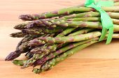 image of immune  - Bunch of fresh green asparagus on wooden surface concept of healthy food nutrition and strengthening immunity - JPG