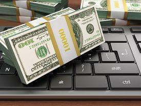 picture of 100 dollars dollar bill american paper money cash stack  - US hundred dollar bills on white modern computer keyboard - JPG