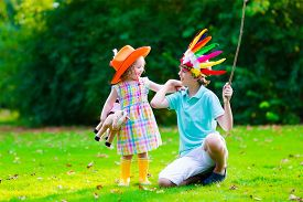 picture of cowgirl  - Kids in cowboy and cowgirl costumes playing outdoors - JPG