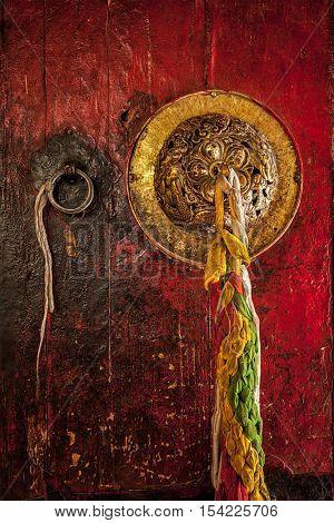 Decorated door handle of gates of Hemis gompa (Tibetan Buddhist monastery). Ladakh, India