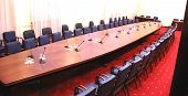 image of public speaking  - photo Empty conference room with microphones and red carpet - JPG