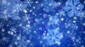 Christmas Background Of Fuzzy And Focused Snowflakes poster