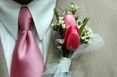 Boutonniere And Pink Tie