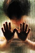 stock photo of child abuse  - Silhouette of abused child behind the glass - JPG
