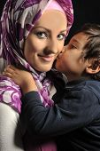 Muslim young woman with little cute kid