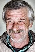 Elderly man, natural smile and positive grimace