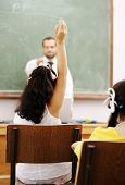 picture of hands up  - Teacher and pupil in school - JPG