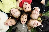 Happiness without limit, happy group of children in circle, together outdoor, faces, smiling and car
