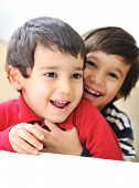 stock photo of tickling  - Two happy brothers tickling - JPG