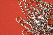 business paper clips in a color background
