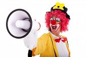 funny clown shouting at the megaphone (isolated on white)