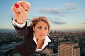 stock photo of hero  - Super businesswoman flying over London city - JPG
