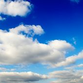Beautiful white fluffy clouds in the blue sky poster