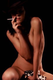 pic of dark-skin  - young woman stripper with cigarette - JPG