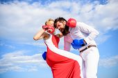 Attack Is Best Defence. Defend Your Opinion In Confrontation. Man And Woman Fight Boxing Gloves Sky  poster