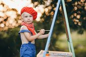 Young Artist Painting An Summer Landscape. Boy Painter On The Nature Of The Artist Draws poster