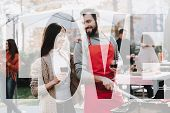 Man And Woman Outside Barbecue Wine Drinking. Smoked Food. Nature Activity. Outside Relaxing Activit poster