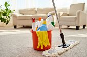 Cleaning Set For Different Surfaces In Orange Bucket And Mop On Floor In Living Room, Copy Space. Cl poster