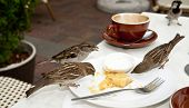 Sparrows on cafe table.