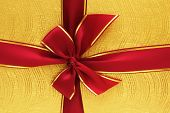 foto of gift wrapped  - Close up of the gift box with red ribbon - JPG