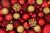 Red and gold christmas bauble decorations forming an abstract festive background. Traditional christ poster