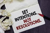 Writing Note Showing Set Intentions. Not Resolutions.. Business Photo Showcasing Positive Choices Fo poster