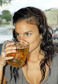 stock photo of bing  - Beautiful young woman drinking beer in big glass buck can be binging alcoholism or other addiction - JPG