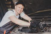 Car Mechanic Working Diagnostic Equipment At Automotive Service poster