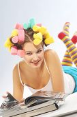 Woman With Hair Curlers And Magazines