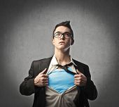 image of superhero  - Businessman showing a superhero suit underneath his suit - JPG