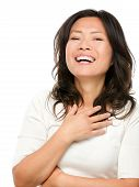 stock photo of early 50s  - Laughing mature middle aged Asian woman joyful and cheerful - JPG